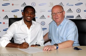 Samuel Eto'o signs in the presence of Chelsea Secretary and Director David Barnard