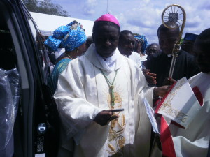Bishop Nkea receives the key of his new car