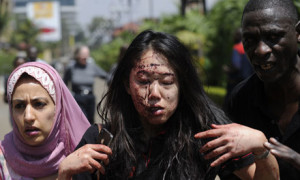 A woman is led to safety following the attack. AFP