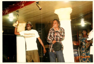 Cent Moko (left)  on stage