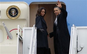 Barack and Michelle Obama arrive SA for funeral