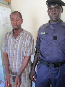 Mamadou Kaba (L) in chains. his 99 days of theft are over