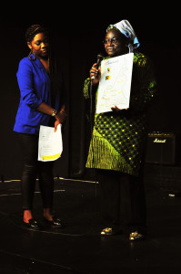 Cameroon Literary Group founder Maria G gives contestant prize in 2013 edition of CGT