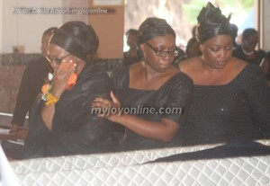 Kwansema Dumor (wife in glasses) and some family members file past coffin