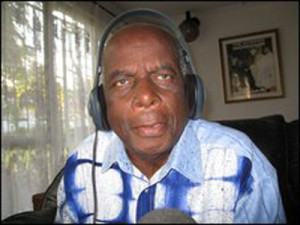 Denis Liwewe  on the mic doing wha he loved doing all his life;giving radio football commentaries
