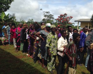 Patients queue to see Dr Bwelle